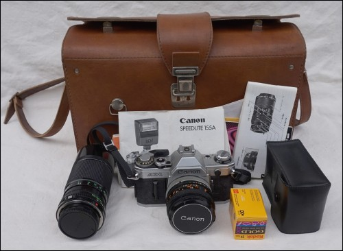 Canon AE-1 Objectif FD 50mm 1:1.8 SC Speedlite 155A 70-150mm 1:4.5 Flash Sacoche